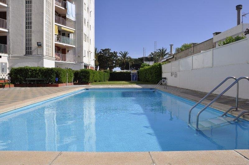 Apartamento con piscinas y vistas al mar en Malgrat de Mar, location de vacances à Malgrat de Mar