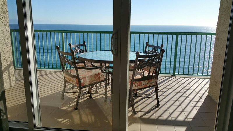 Direct Oceanfront Balcony with Dining Table and Chairs