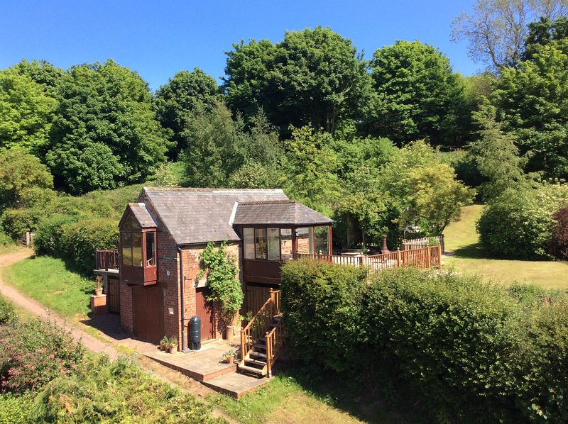 The Coach House is situated in two acres of woodland on a private lane that leads up to the moors