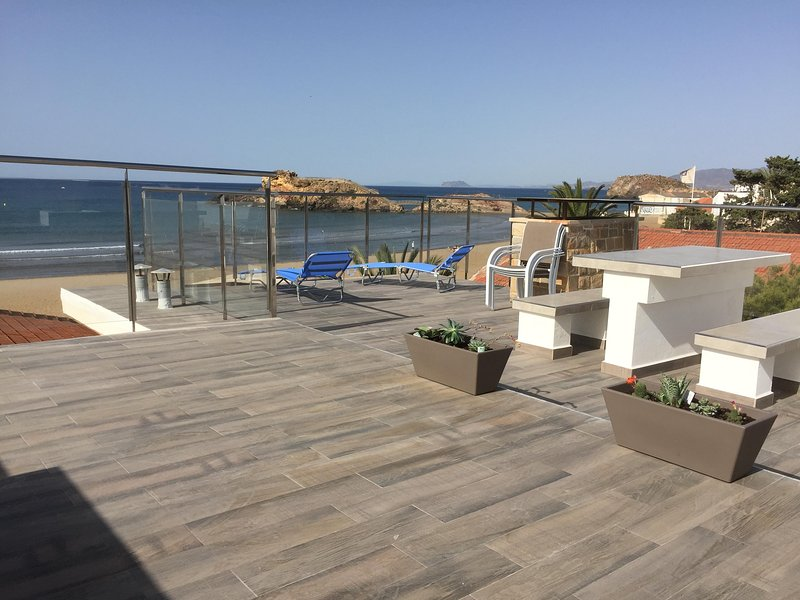 Roof terrace and view of the beach