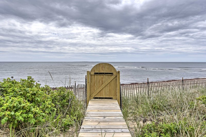 The home is just steps from the sandy beach shore!