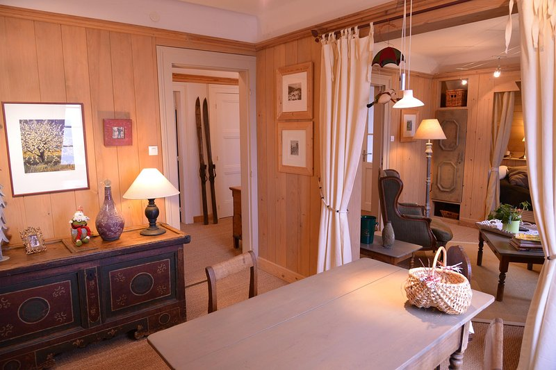 Living room of our Mountain Hiker apartment in La Vancelle, Alsace. Walls are covered with wood.