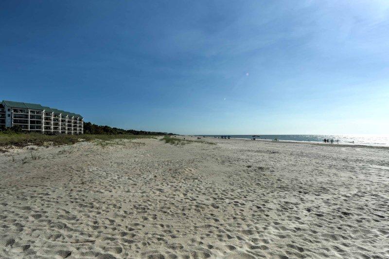 Enjoy long walks on the sandy beach just steps away!