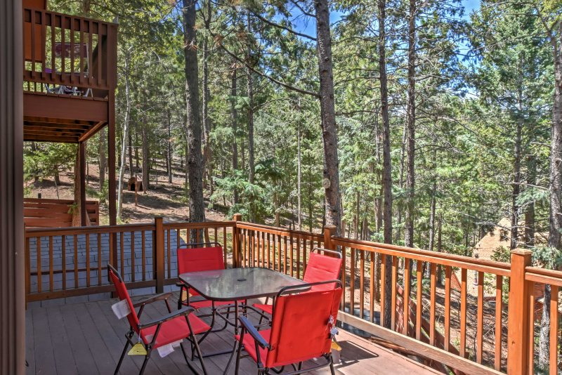 Eight guests can enjoy the private setting and picturesque views from the deck.
