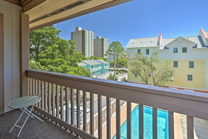 A relaxing Southern retreat awaits you at this 2BR, 2.5-bath Myrtle Beach condo.