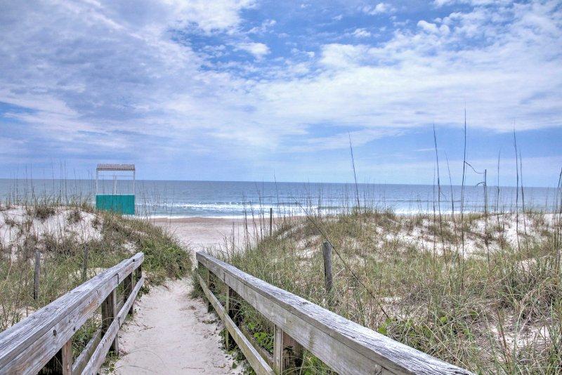 The perfect beach retreat awaits you at this 2-bedroom, 2-bathroom vacation rental condo in Carolina Beach!