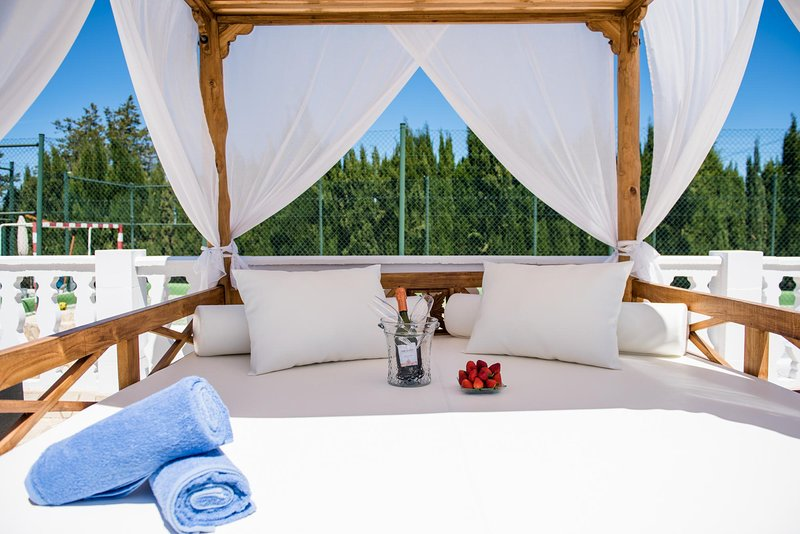 outdoor bed by the pool