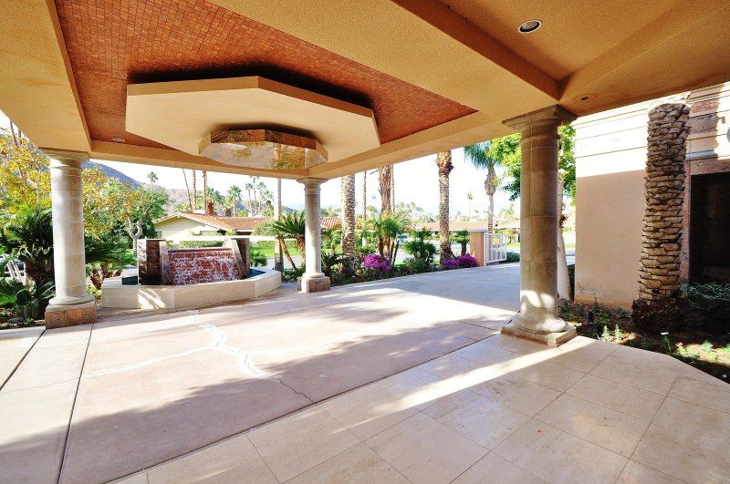 Lighted Porte-cochere with a Feature Fountain