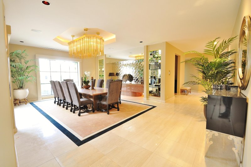 Formal Dining Room that Seats Ten and is Brightened by an Exquisite Chandelier