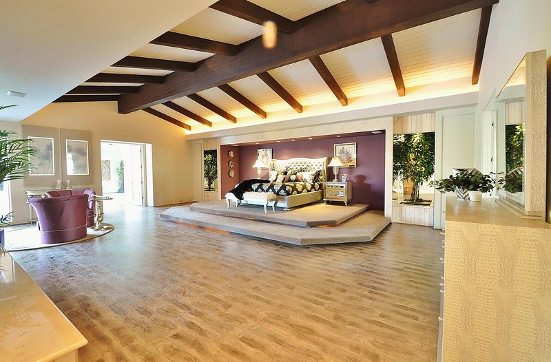 Master Bedroom with Cal King Sized Bed and 60' LED TV