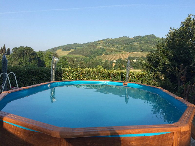 CA ' three valleys ' delightful apartment surrounded by greenery of the Apennines between Faenza and Forlì, holiday rental in Oriolo
