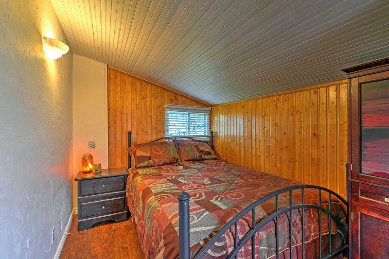 Sleep soundly in this cozy bedroom's queen bed.