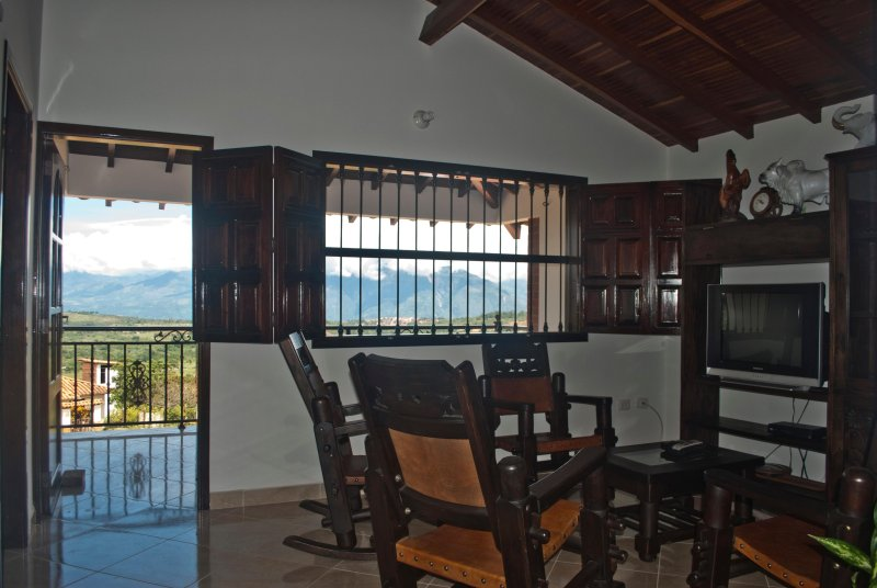 TV room (with wooden rocking chairs) and the wider viewpoint (with hammock)