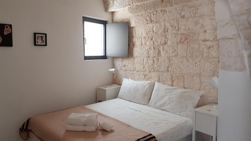Bedroom is airy and comfortable