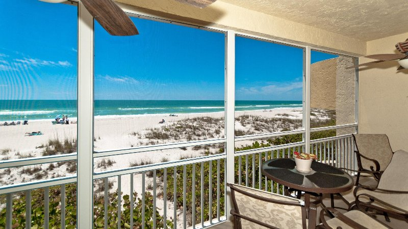 22 foot long screened lanai has e second set of stairs direct to the beach.