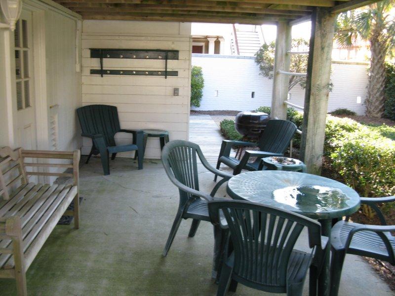 Ground Floor back yard Patio area under upper deck, has outdoor shower area and door to  inside.