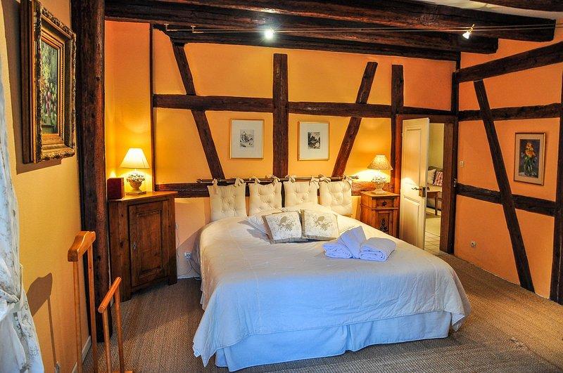 La chambre principale avec lit king size 180x200 cm