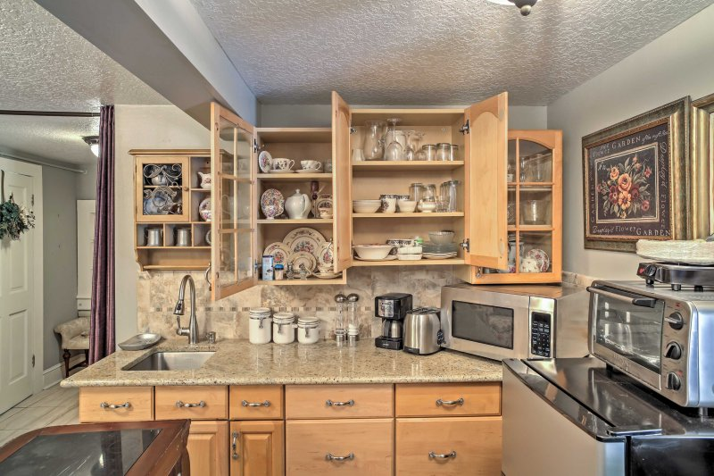 Off of the bed area, the kitchenette includes a microwave, a small refrigerator, and sink for easy clean-up.