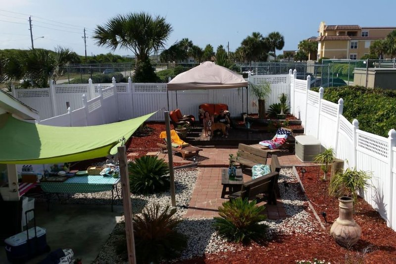 Large yard with decks, pavers, fully fenced