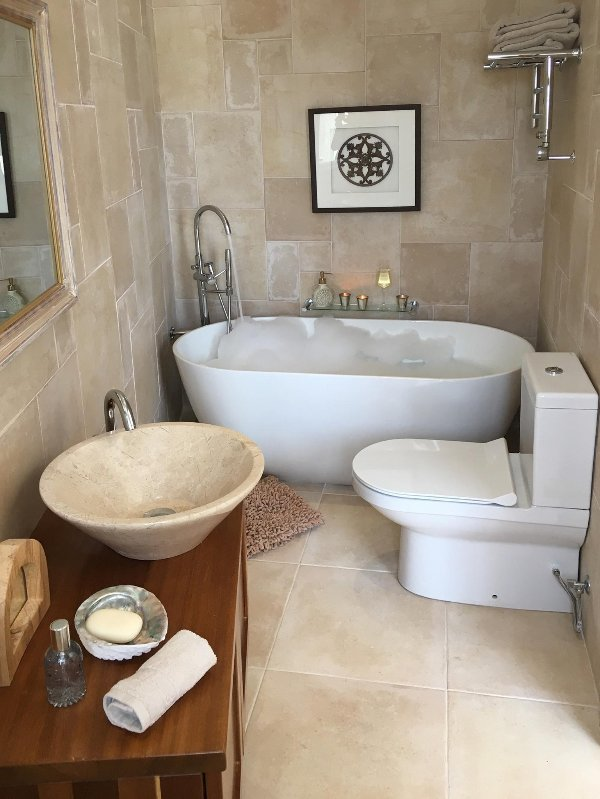 En suite with Huge tub,  walk in shower and heated rail for fluffy towels!