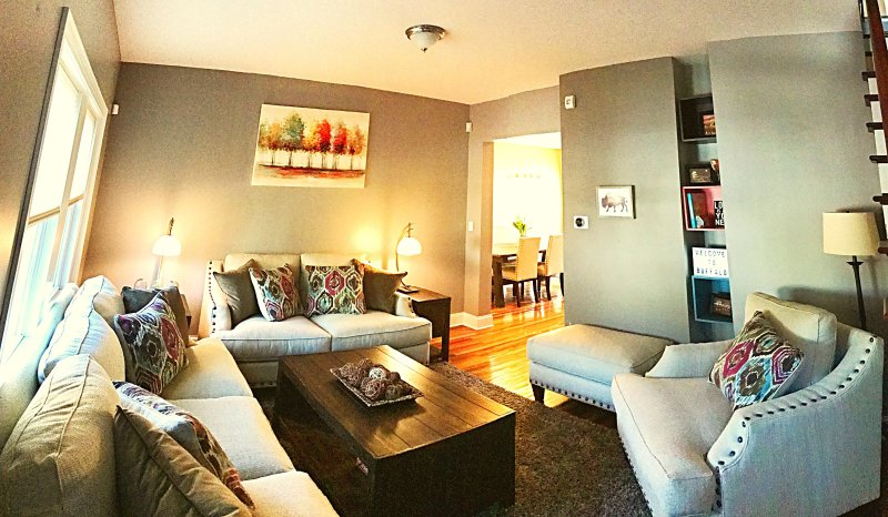 The front sitting room is designed for a communal feel, with plenty of room for your entire group.