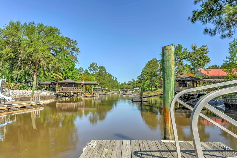 Situated right on the river, this home offers both tranquility and convenience!