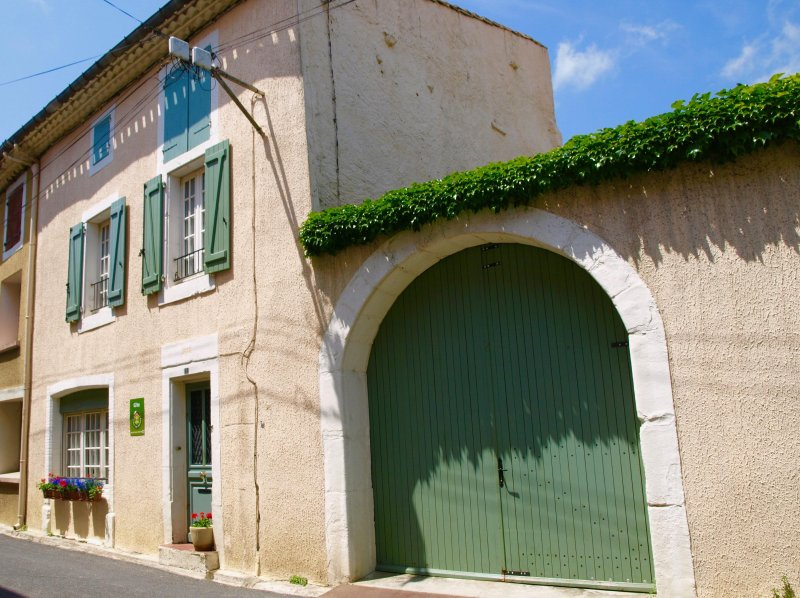 Stunning house with green shutters and  double gates to courtyard  and terrace