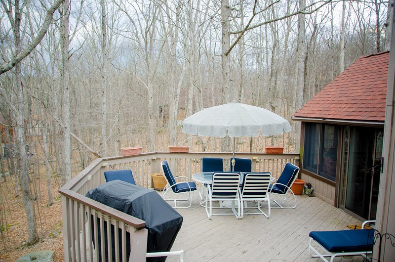 Lovely deck with a brand new grill, deck furniture and lounge chairs.