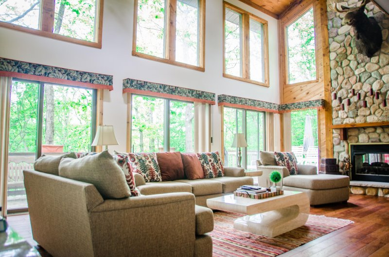 The bring and cozy living room with wonderful view of the nature outside