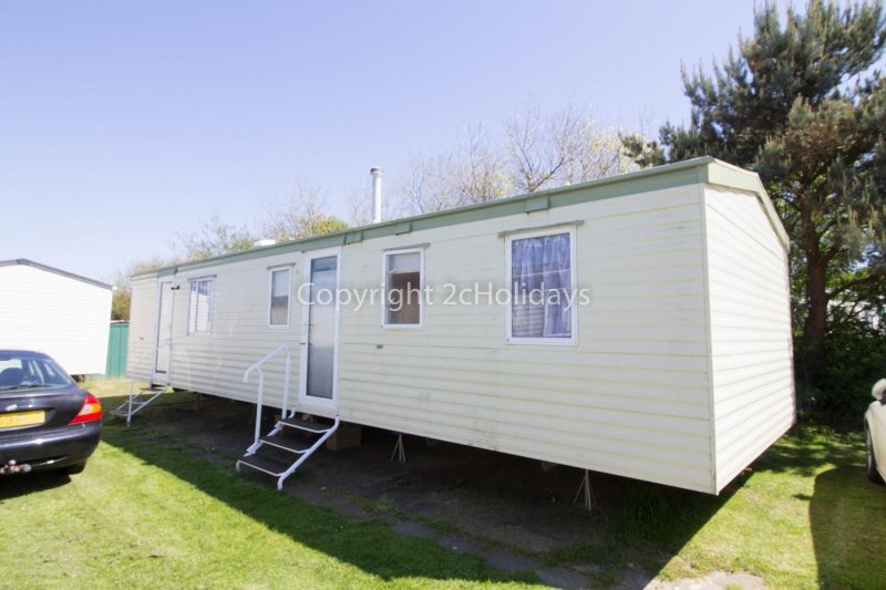 8 berth caravan for hire at Broadland Sands Holiday Park. Emerald rated.