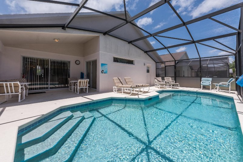 Large pool deck, great for sunbathing. Covered patio dining area.
