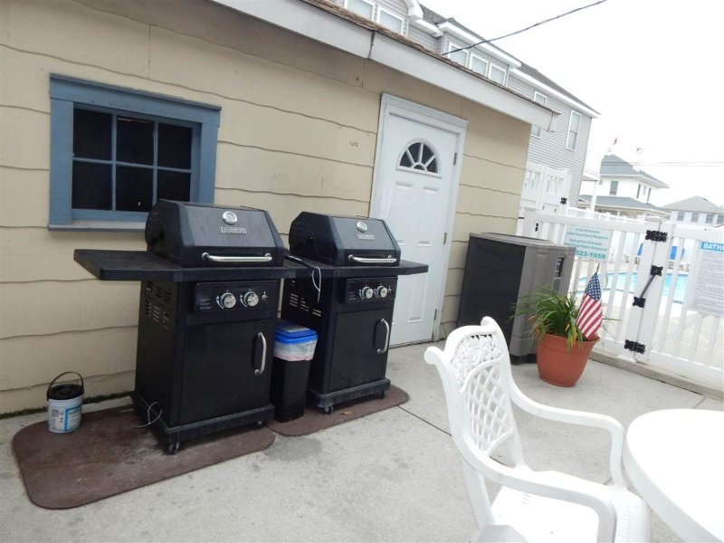 Two BBQ grills, also located steps away from front door.