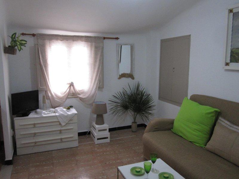 salon dormitorio con sofa cama planta superior