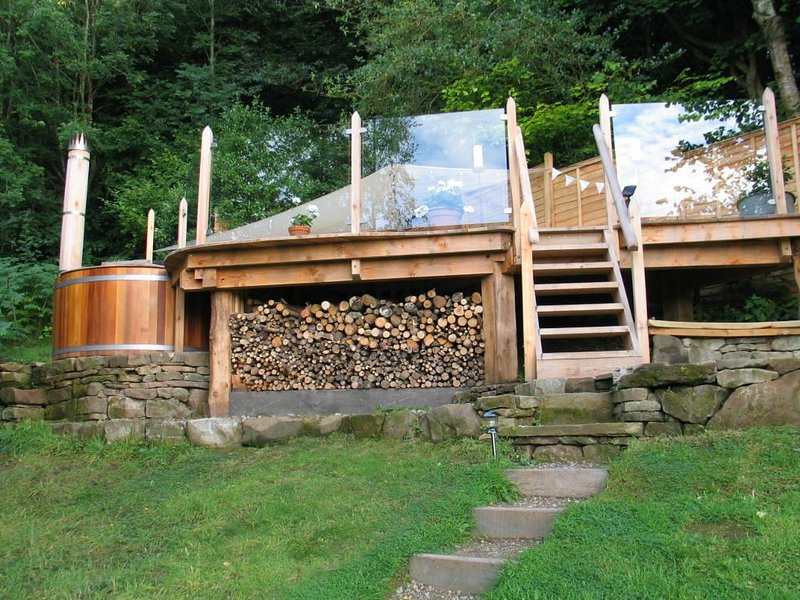The elevated deck and woodfired hot tub