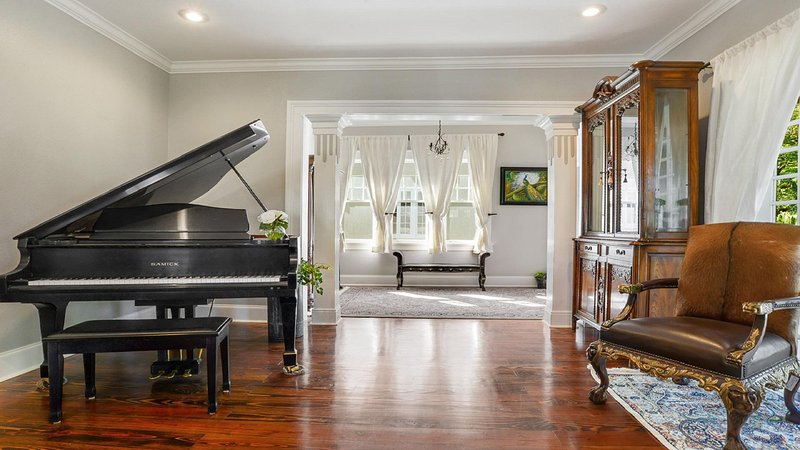 Large parlor with baby grand piano