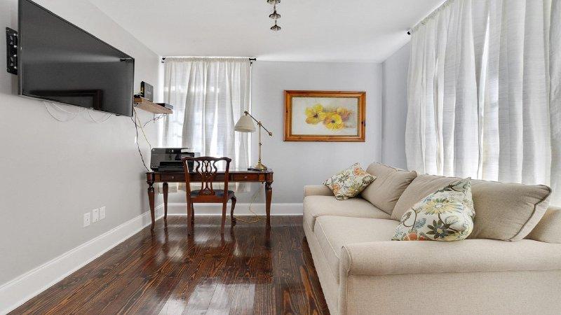 Sitting / TV room in master suite with queen sofa sleeper and separating door