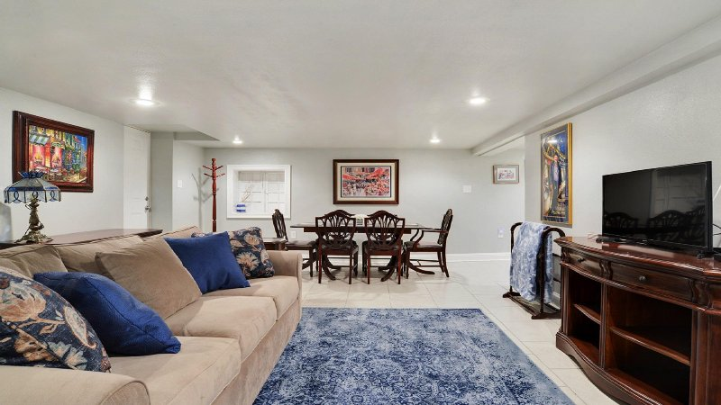 Downstairs secondary living area for parties more than 12 available with additional fees