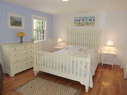 Master Bedroom with Queen Bed and Half Bath