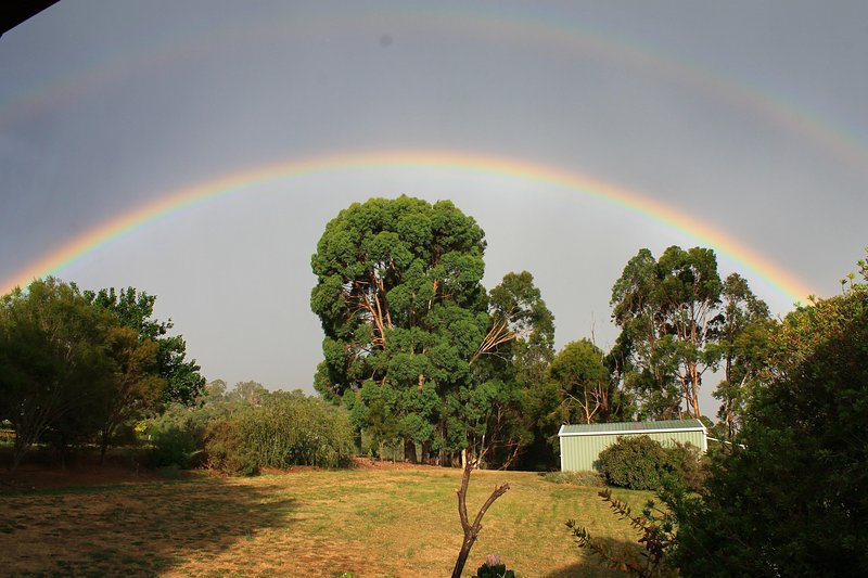 Prelude to a storm - double rainbow looking east from the front verandah