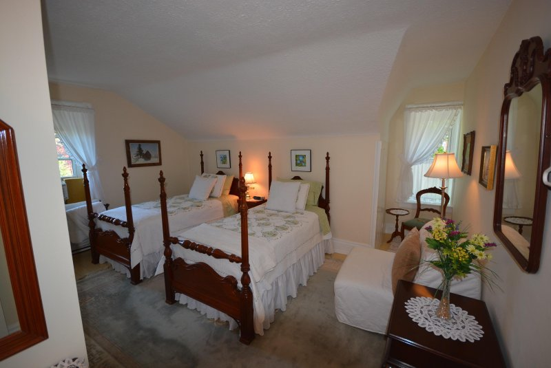 Our Postmaster's Chamber Quilts grace the antique mahogany four poster beds