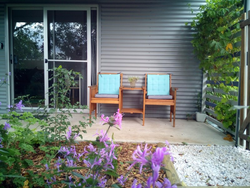 Relax with your coffee on the verandah and look out on the cottage garden