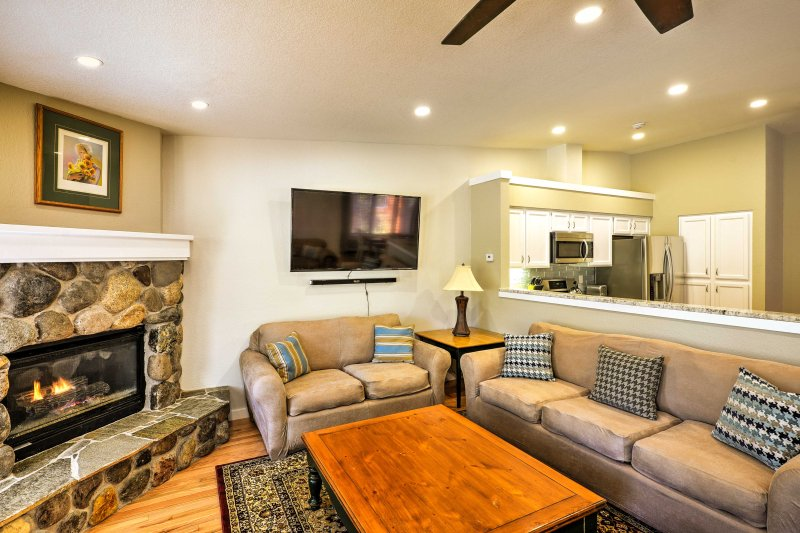 Sink into the comfortable furnishings in the living area to watch TV.