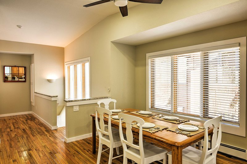 Enjoy meals with at view at the beautiful wood dining table.