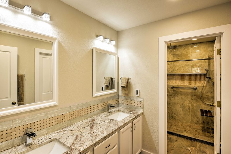 The en-suite bathroom has a walk-in shower and double vanity.