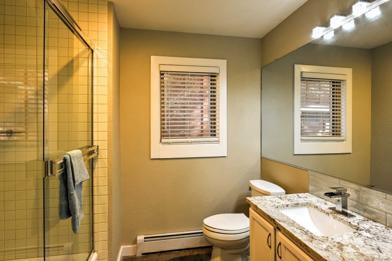 The second bathroom includes a walk-in shower.