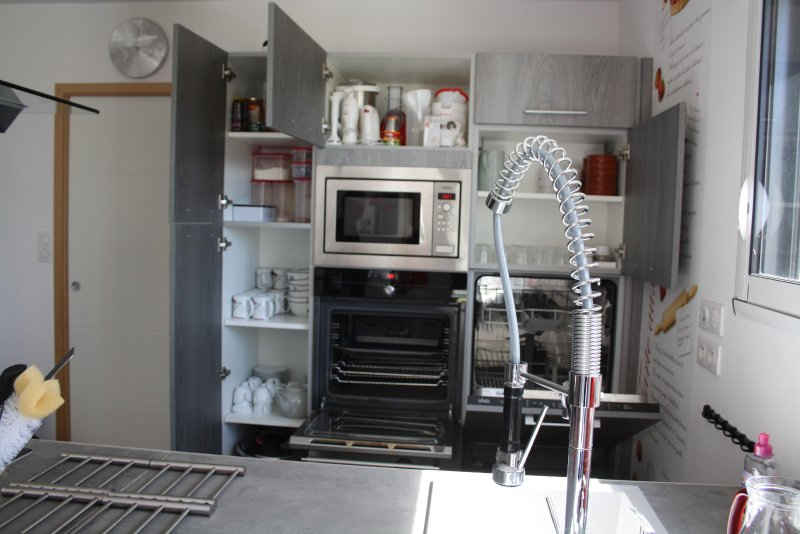 Dishwasher in height, cold door oven, microwave.