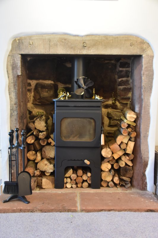 Log-burning stove - perfect after a bracing walk on the beach.