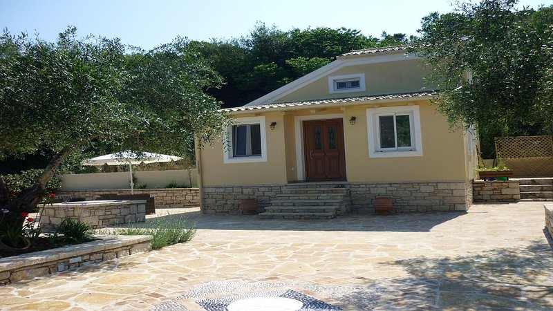 Romantic cottage with private pool amid ancient olive grove, old Erimitis wood and Avlaki beach.