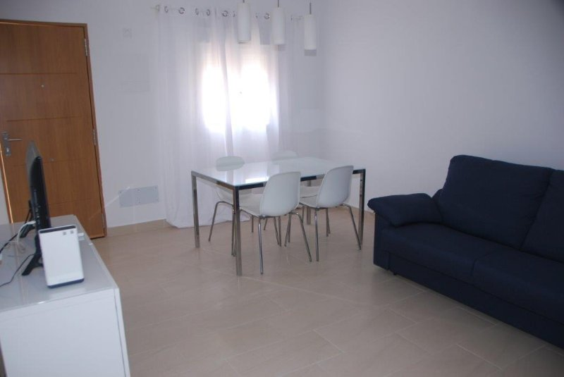 TV lounge with table for four people with sofa