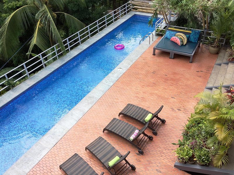 Terracotta tiled pool deck and the salt-water lap pool